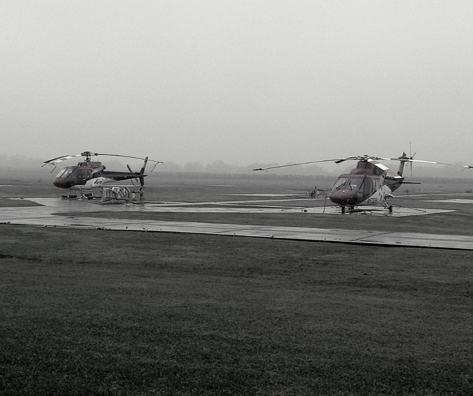An ERA Astar and S76 helicopter on the ramp waiting for weather to improve