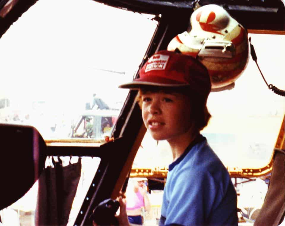 Young Darcy Hoover sitting in a helicopter cockpit