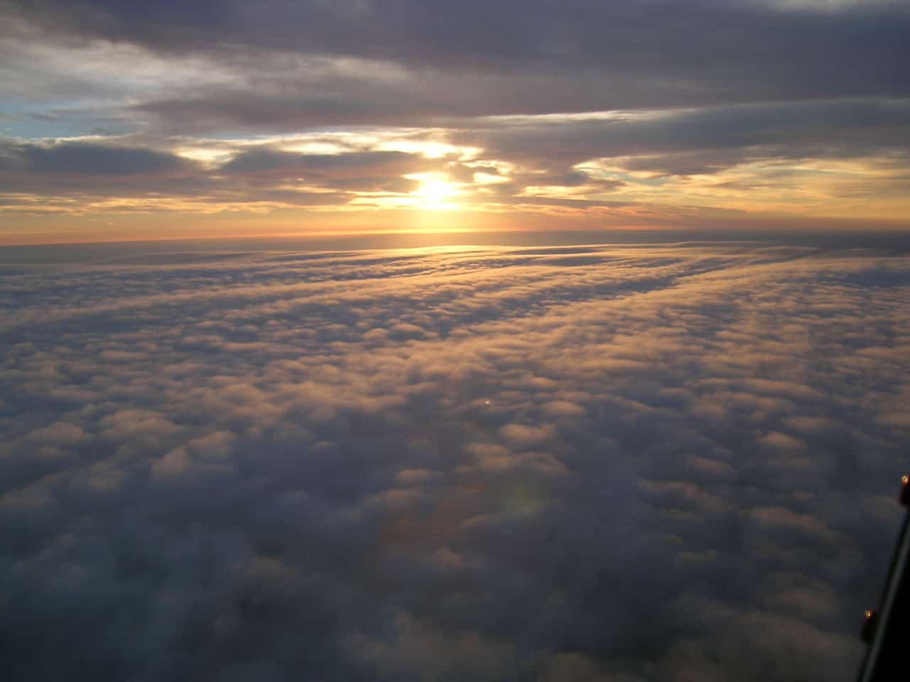 Sunshine above a blanket of clouds