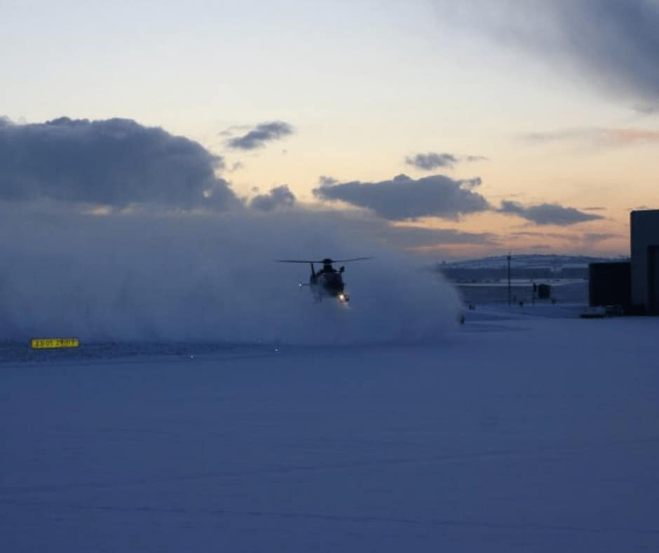 The EC135 operated by the Aer Corps for the Garda Air Support Unit landing in the snow