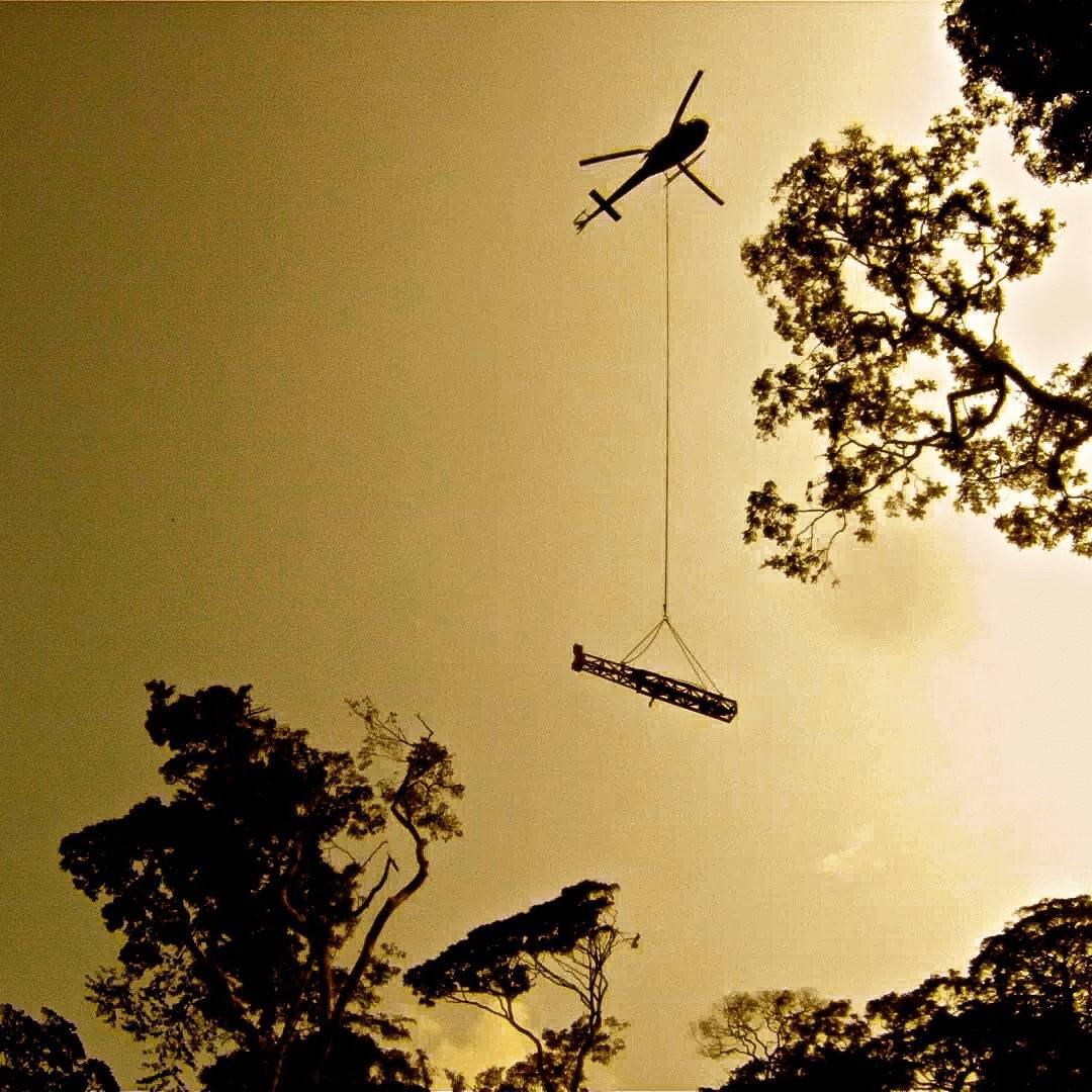 Moving equipment over the Jungle Canopy in an AS350 Astar
